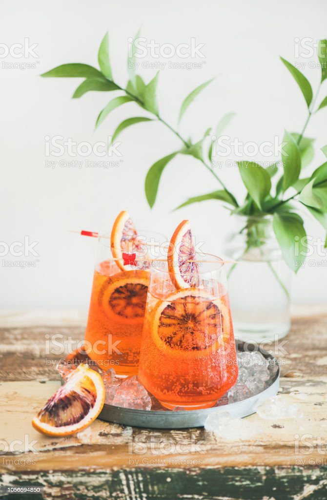 Aperol Spritz cocktail drink with orange and ice on table stock photo