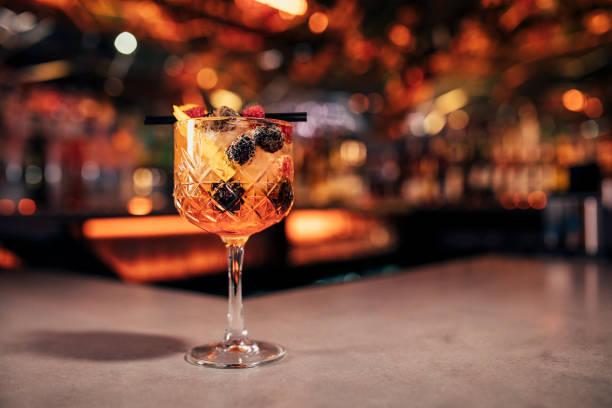 Spritz cocktail with dark fruit garnish picture id1019323402?b=1&k=6&m=1019323402&s=612x612&w=0&h=1sn1mvpt8krzqxqolyd nob9ttdoyt4fhzfaqw5nxym=