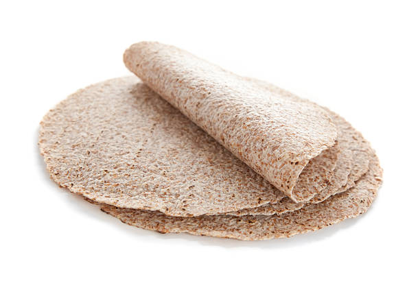 Sprouted wheat tortillas Sprouted wheat tortillas isolated on white whole wheat stock pictures, royalty-free photos & images