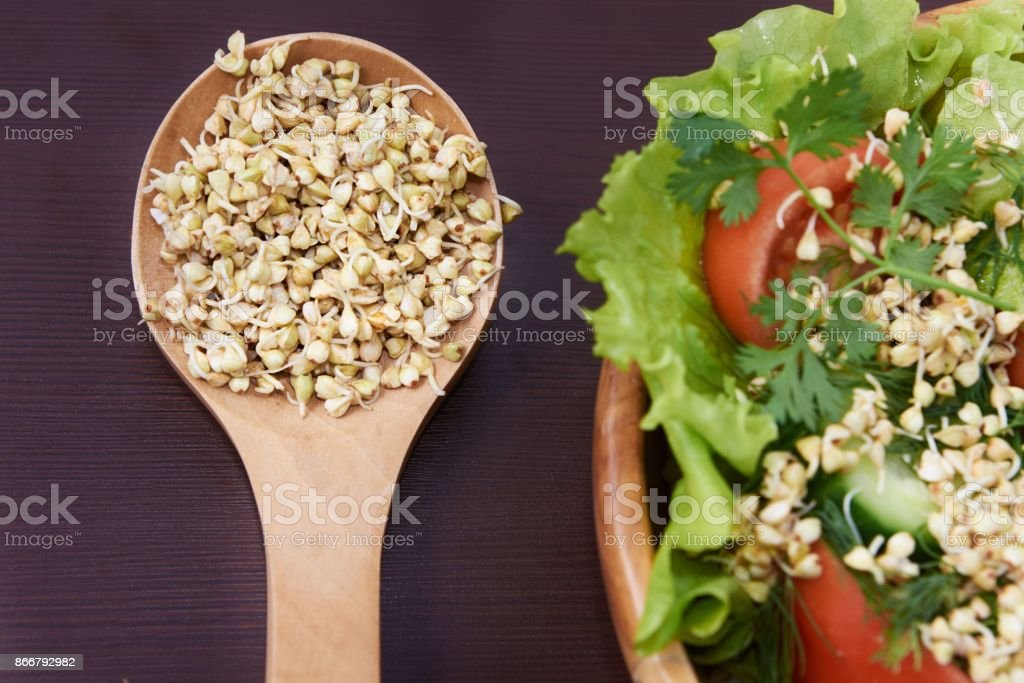 Sprouts. Buckwheat. Health. Vegetarianism. Snack. Salad stock photo