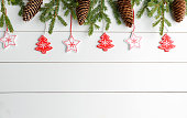 Spruce branches and cones on a white wooden background