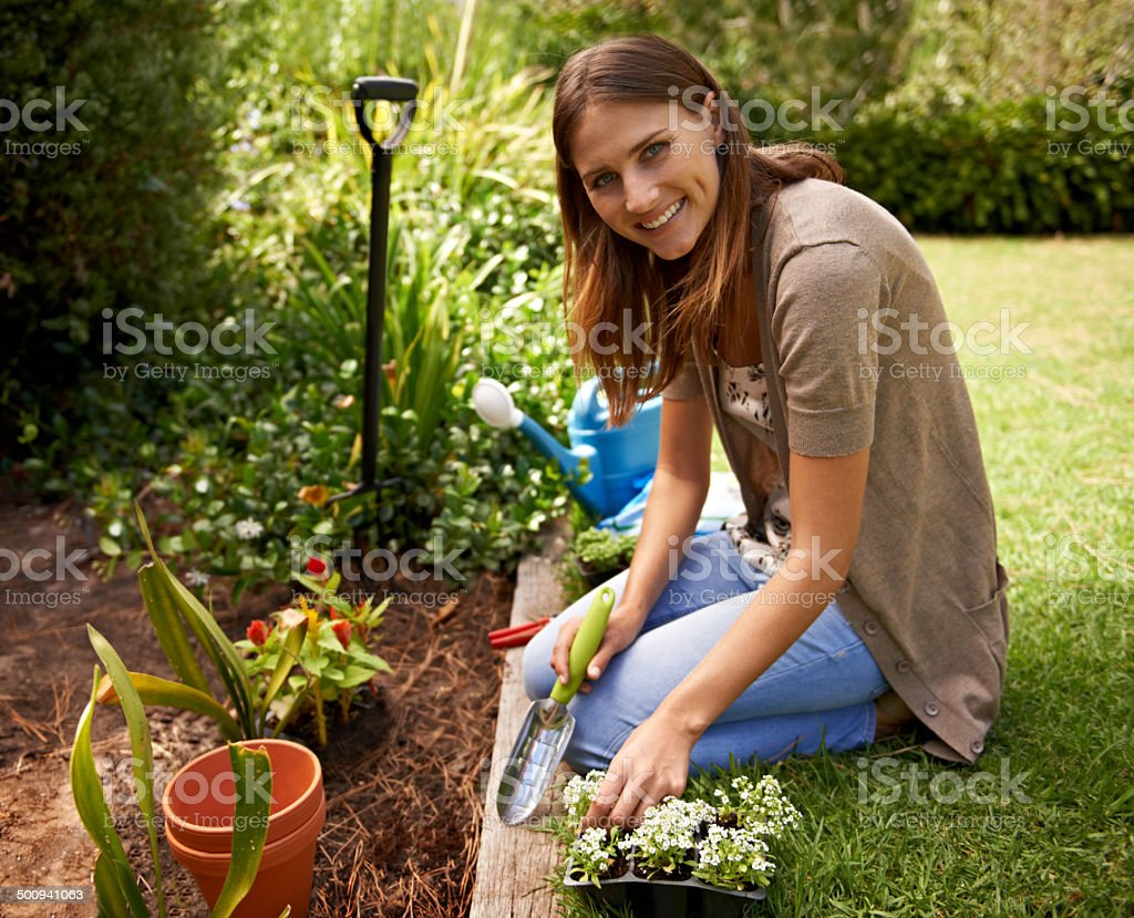 Sprucing up her garden with a few choice additions stock photo