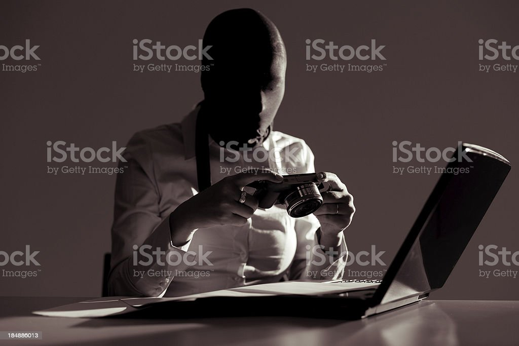 Spy taking photograph of important data stock photo