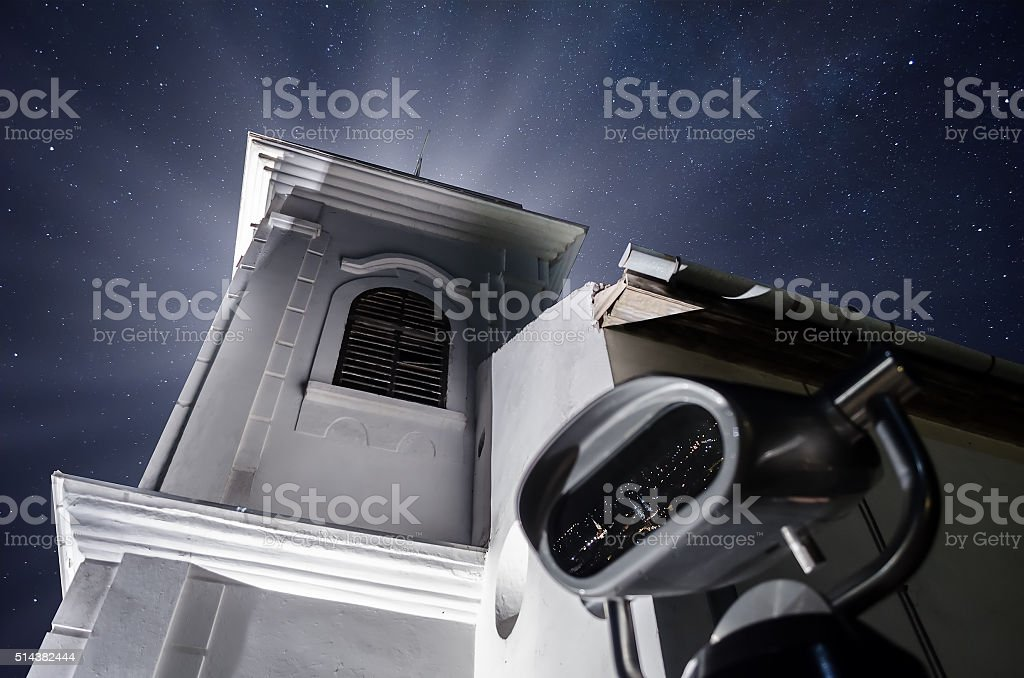 Spy viewing machine and church in the background stock photo