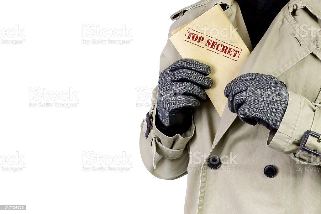 Spy with top secret documents. stock photo