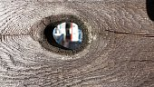 istock Spyhole in a wooden fence 538144851