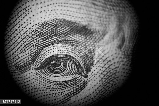 istock Spying money. 871717412