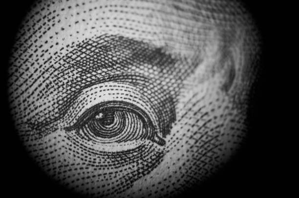 Spying money. Macro of one hundred dollars greed stock pictures, royalty-free photos & images