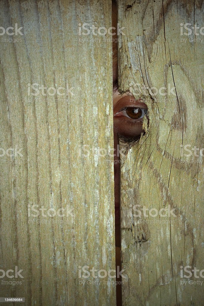 Spying on people through peephole, copy space royalty-free stock photo