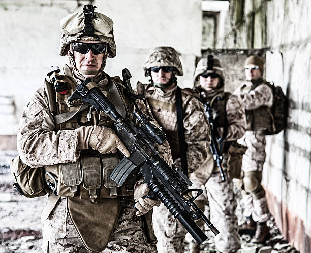 Squad of marines Squad of US marines in ruined building us military stock pictures, royalty-free photos & images