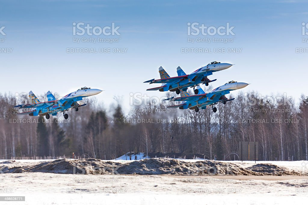 Squad of russian fighters Su-27 taking off from air base royalty-free stock photo