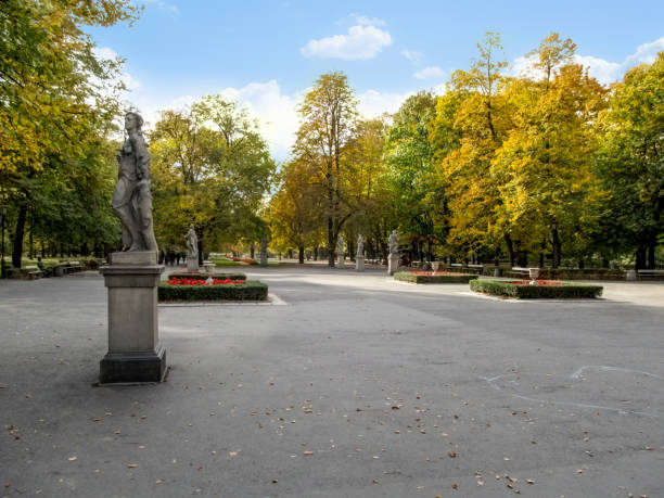Square and alley with sculptures among yellow trees in the Saxon Garden in Warsaw, Poland stock photo