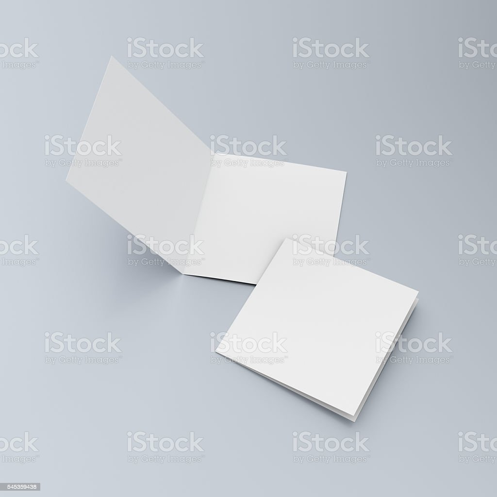 Square blank leaflets or brochures on blue stock photo