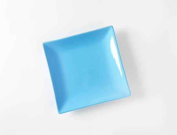 square blauer speiseteller - melamin geschirr stock-fotos und bilder