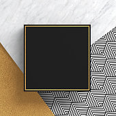 A square border frame on white marble stone and gold surface with a zigzag pattern on black background. Copy space. Abstract geometric composition.