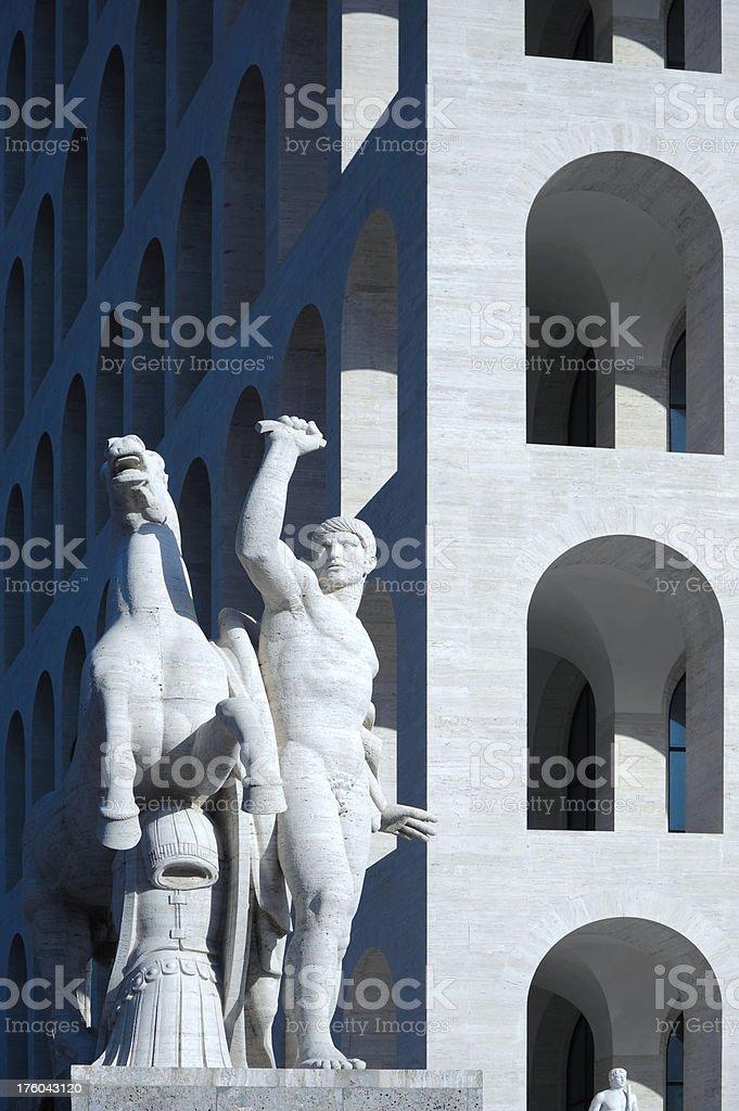 Square Coliseum statue and arcs stock photo