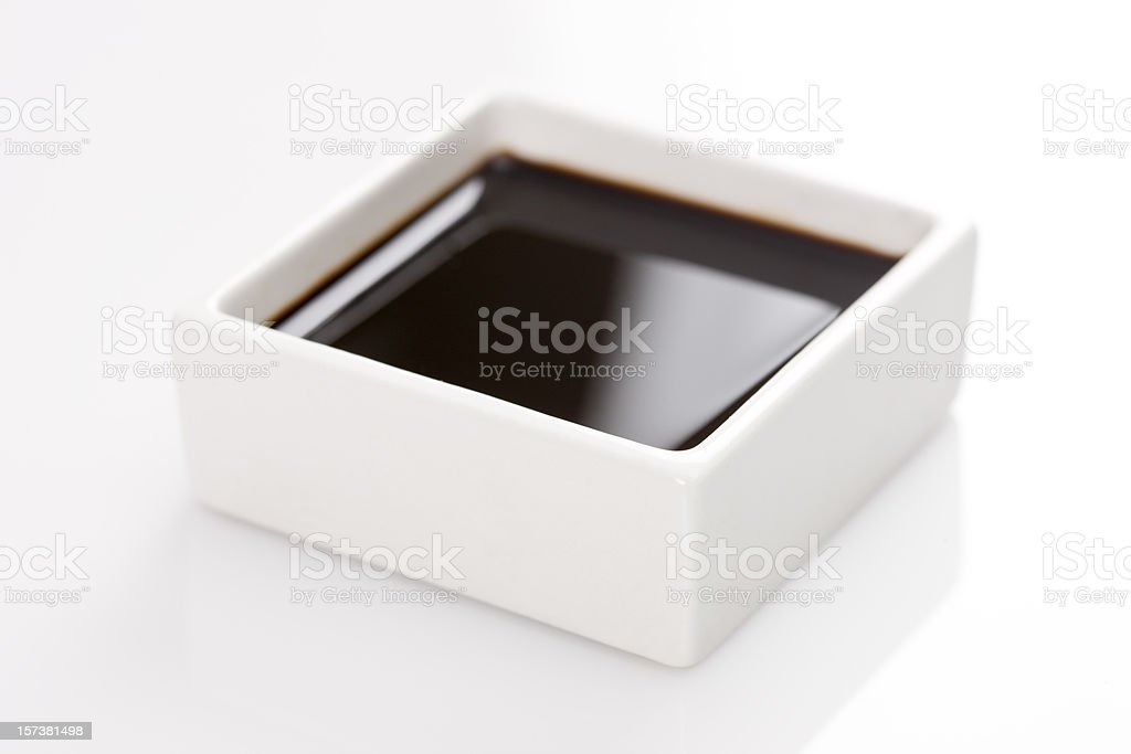 A square container of soy sauce stock photo