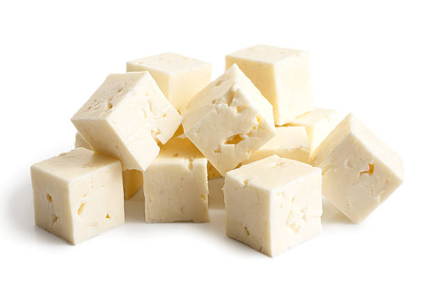 Square cubes of feta cheese isolated on white. Square cubes of feta cheese isolated on white in perspective. feta cheese stock pictures, royalty-free photos & images