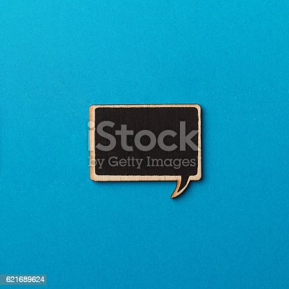 istock square empty chalk board speech bubble on blue paper 621689624