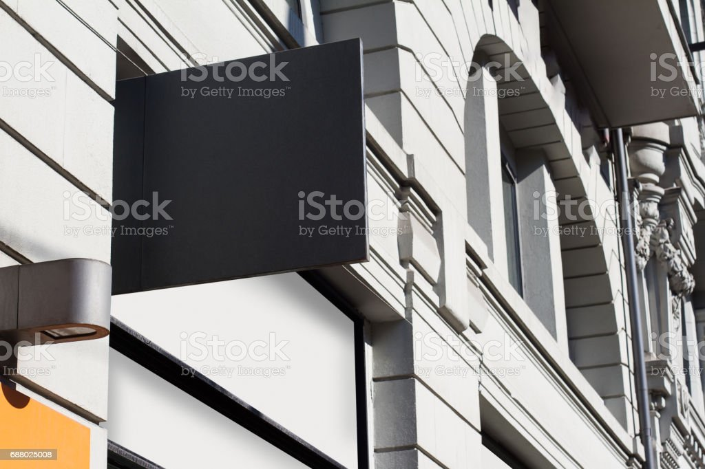 square empty signboard on a building with classical architecture stock photo