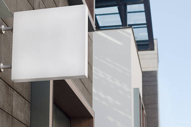 square empty signboard on a building with modern architecture stock photo