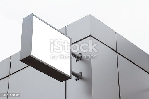 istock square empty white signboard on a building with modern architect 637158542