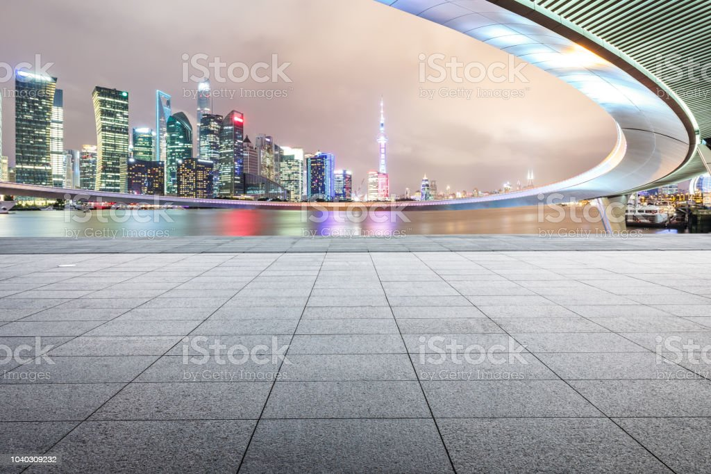 Square floor and modern city buildings with bridge in Shanghai at night stock photo