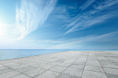 square floor and sea water under the blue sky