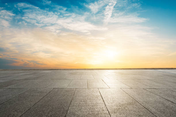 square floor and sky at sunset - diminishing perspective stock photos and pictures