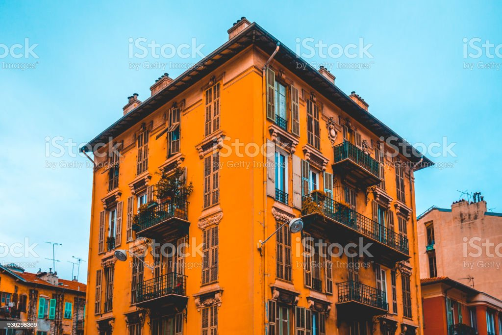 square formed old apartment building in a mediterranean city stock photo