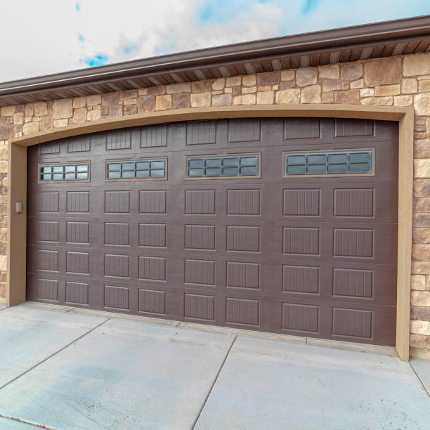 Square frame Large closed double wooden garage door day light stock photo