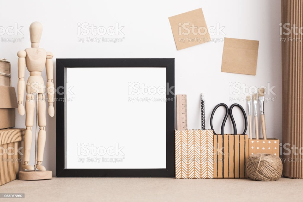 Square frame mock up on stylish young student desk. Mock up. stock photo