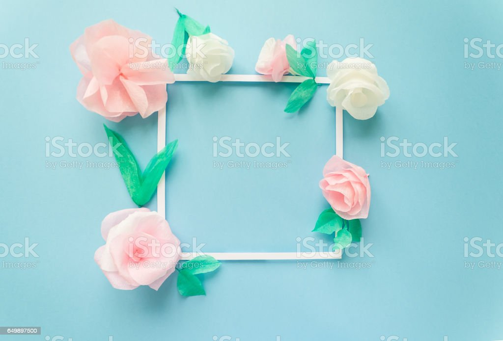 Square frame with color paper flowers on the blue background flat square frame with color paper flowers on the blue background flat lay nature concept mightylinksfo