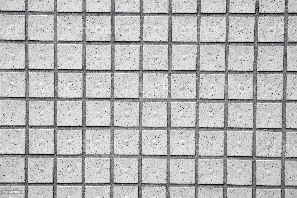 Square gray tile array with dark grout royalty-free stock photo