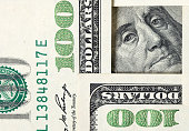 Square made of $100 banknotes with Benjamin Franklin portrait inside.