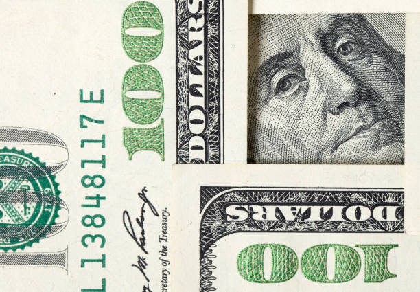 Square made of $100 bills with Benjamin Franklin inside stock photo