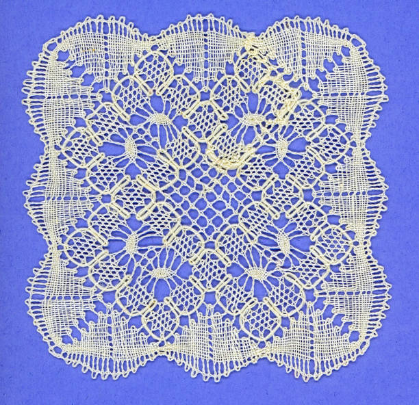 square of bobbin lace worked in linen stock photo