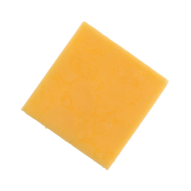 Square of gouda cheese on a white background stock photo