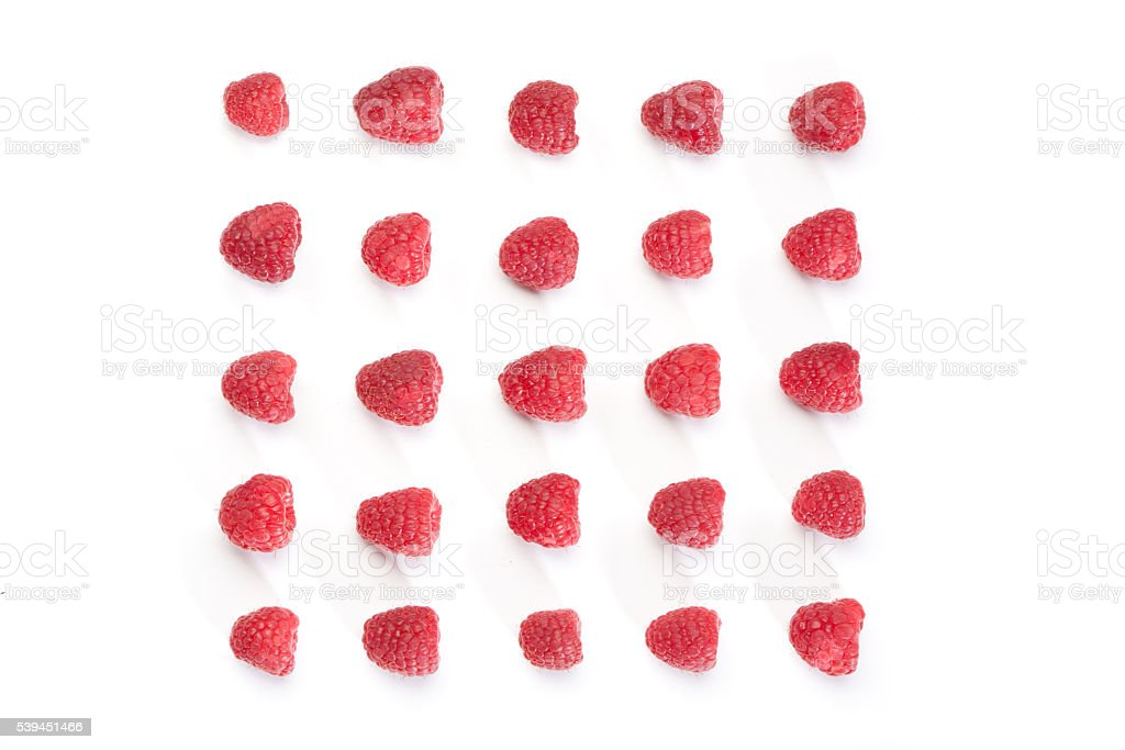 Square pattern of red raspberries from above stock photo