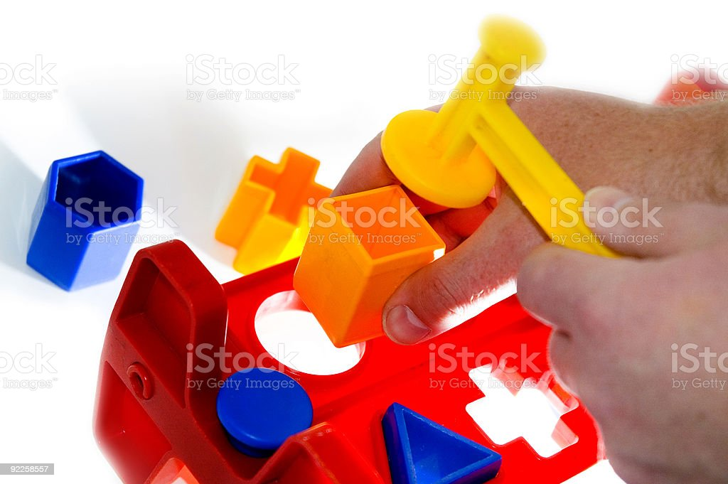 square peg, round hole stock photo