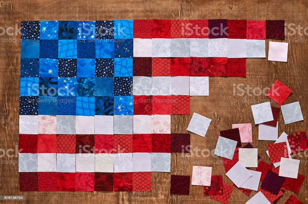 Square pieces of fabrics lying like a flag of USA stock photo
