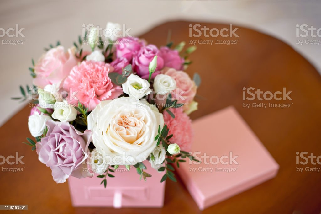 Square pink flower box with a secret department with a tile of...
