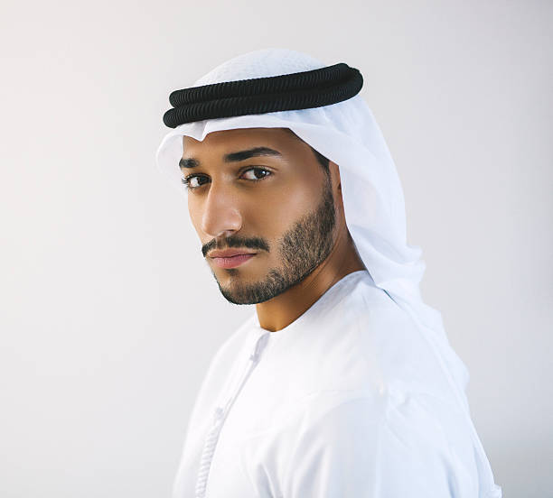 square portrait of arab man in traditional clothing - styles stock photos and pictures