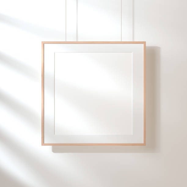 square poster with wooden frame mockup hanging on the wall with shadows - square stock pictures, royalty-free photos & images
