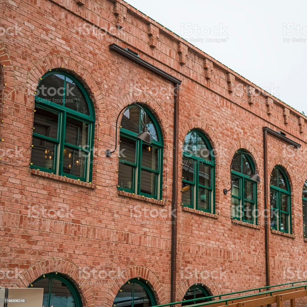 Square Restaurant Exterior In Park City With Red Brick Wall And Green Arched Windows Stock Photo Download Image Now Istock