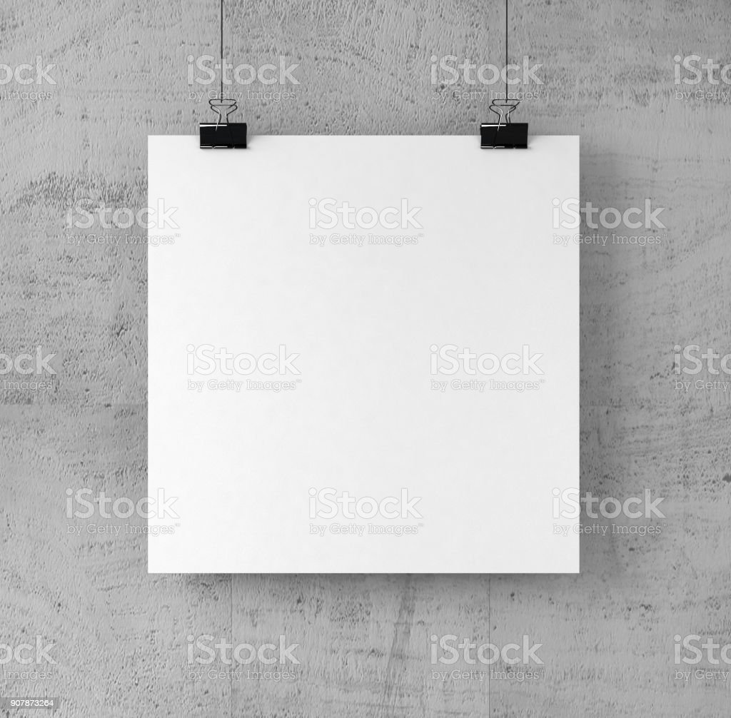 Square Shape Poster on binder clips on Concrete wall. stock photo