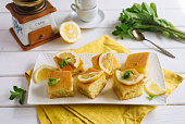 istock Square slices of lemon pie with slices of fresh lemon and mint leaves. 1219557165