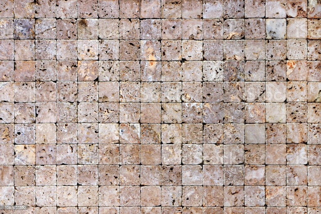 Square stones surface background. Travertine masonry tiles cladding...