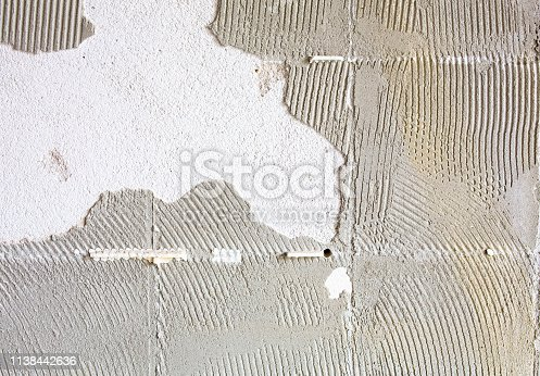 istock Square tile glue plaster wallpaper background texture 1138442636