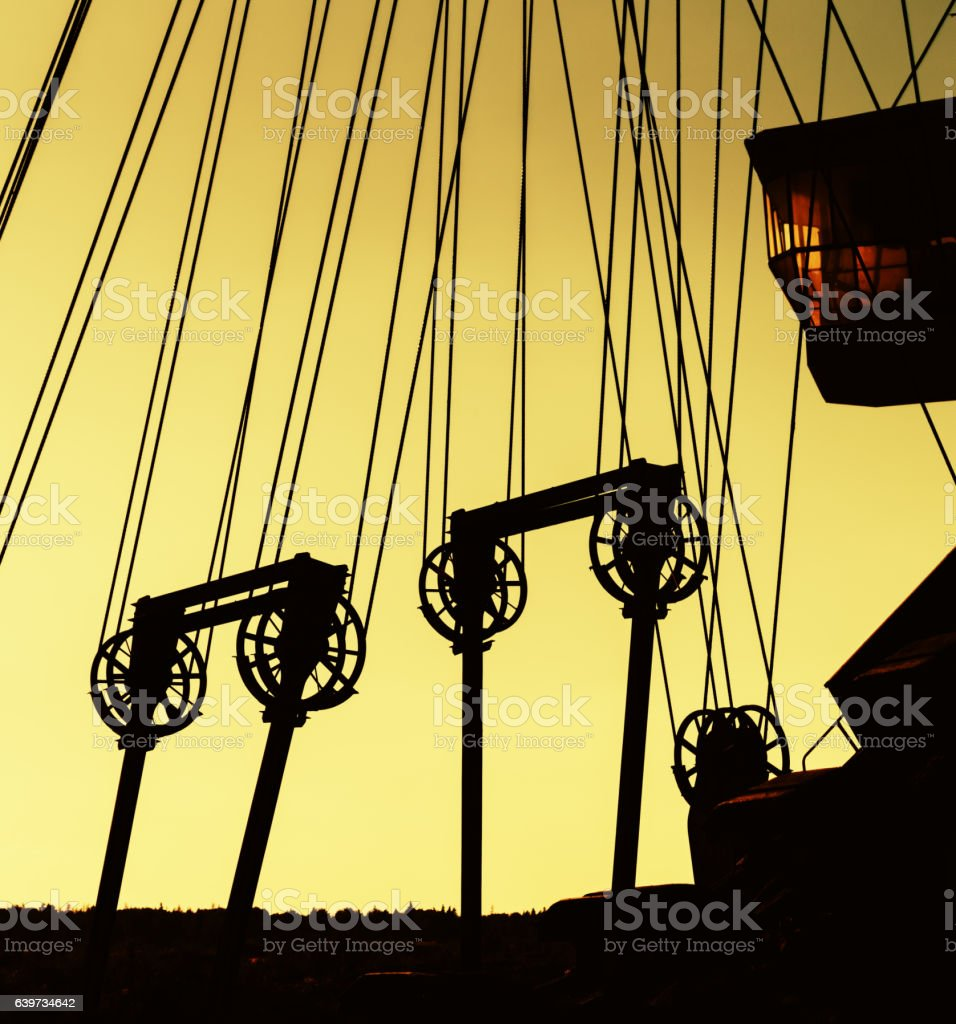 Square vivid orange cyberpunk sepia diging machine sunset evenin stock photo